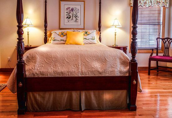 A new breadspread and pillows can brighten a master suite.