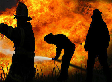 Firefighters fight a fire.