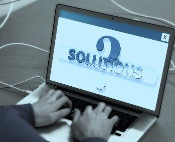 Laptop with solutions on it to real estate information overload.