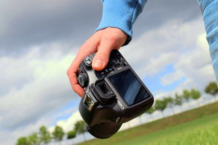 Man holding a camera about to take professional real estate photography.