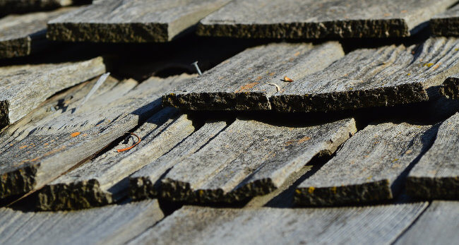Repairing or replacing an old roof is a good way to add resale value to your home.