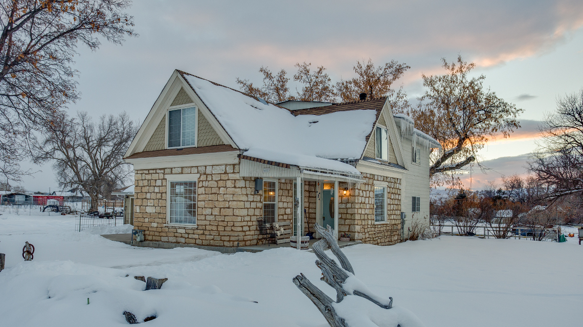 Exterior photo of oolite historic built home in Spring City